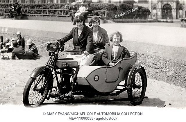 Three ladies at the seaside sitting on a 1923 Rudge Multi 500cc side valve motorcycle & sidecar circa 1920s