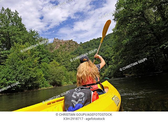 canoeing on the Sioule River with the ruins of Chateau-Rocher in the background, Puy-de-Dome department, Auvergne-Rhone-Alpes region, France, Europe