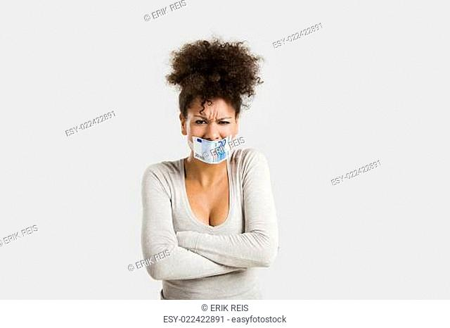Covering mouth with a euro banknote
