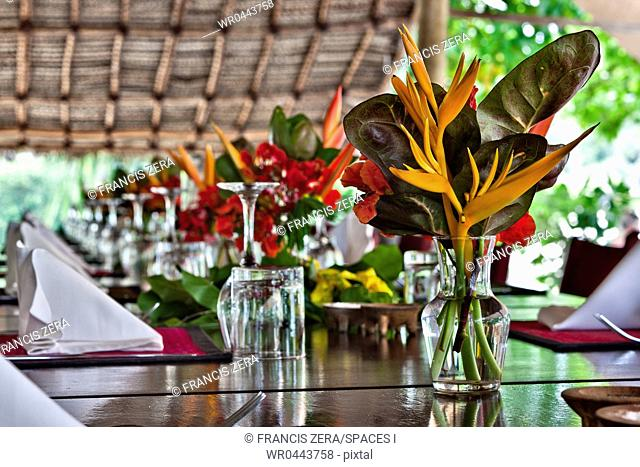 Flowers On Open Air Restaurant Dining Table