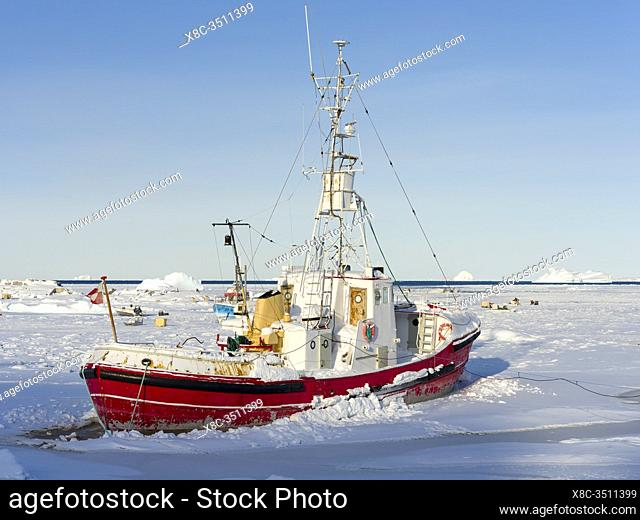 Frozen harbour. Winter in the town of Upernavik in the north of Greenland at the shore of Baffin Bay. America , Denmark, Greenland