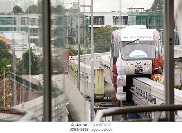 Monorail approaching Tun Sambathan station, Bukit Petaling, Kuala Lumpur, Malaysia, Asia