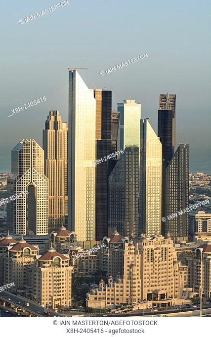 Skyline of skyscrapers on Sheikh Zayed Road at sunrise in Dubai United Arab Emirates