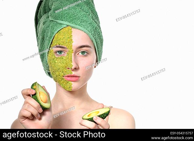 Natural Cosmetics On Woman In Facial Mask With Avocado