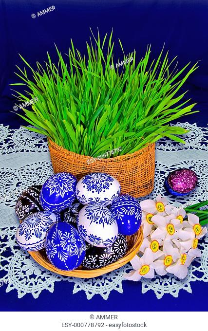 Blue ornamental Easter eggs, bouquet of daffodils a young wheat-grass