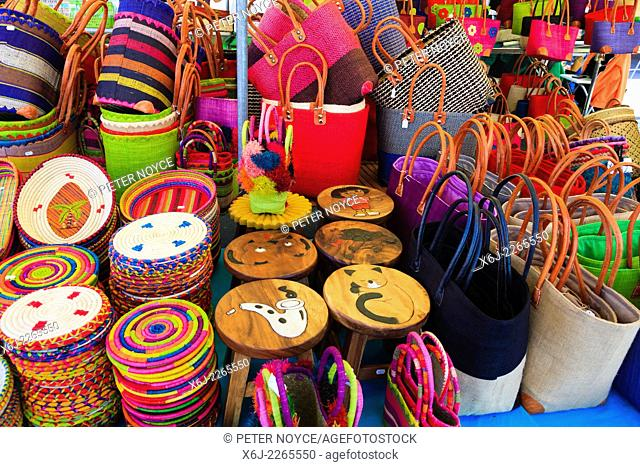 Colourful bags and place mats on market stall