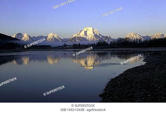Reflection of mountains in a lake, Grand Teton National Park, Wyoming, USA