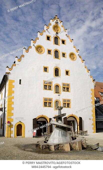 White and yellow facade of the Stadtsall hotel building in the medieval town of Nordlingen, Bavaria, Germany