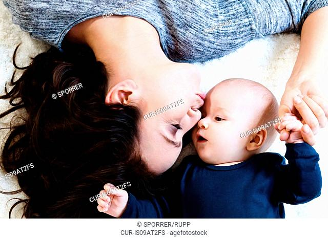 Overhead view, mother kissing baby boy on forehead
