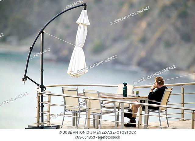 Man relaxing on terrace