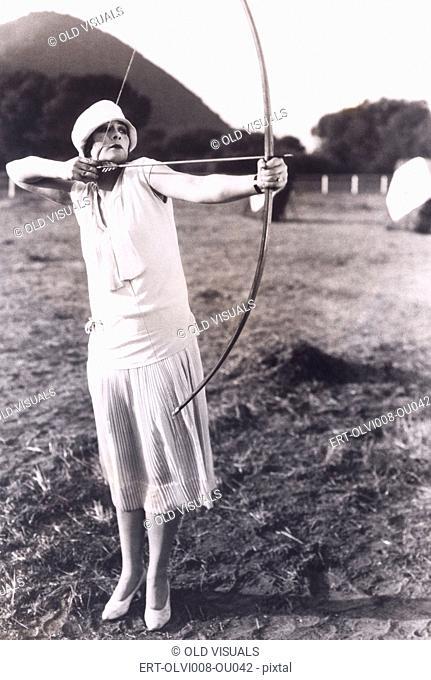 Woman practicing archery (OLVI008-OU042-F)