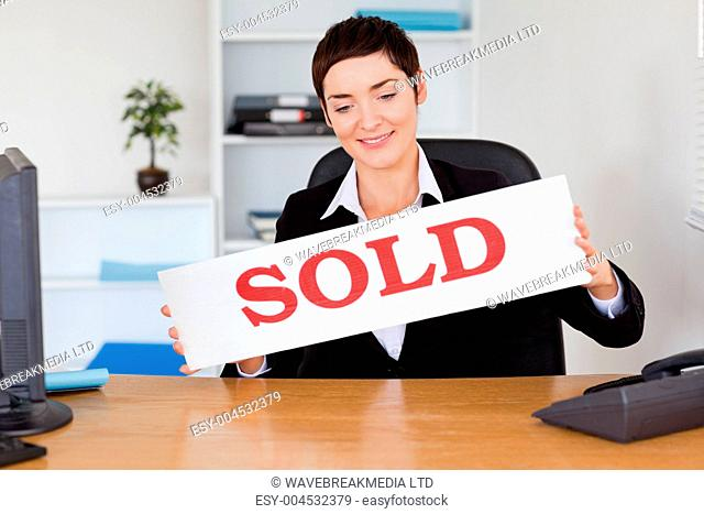 Real estate agent with a sold panel