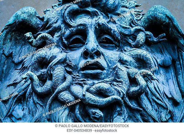 Italy, Turin. This city is famous to be a corner of two global magical triangles. This is a Medusa's head made of bronze close to the historical garden of...