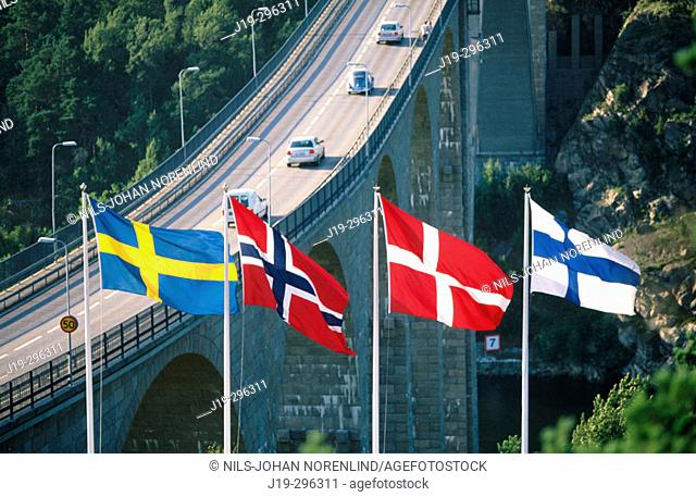 Scandinavian flags by Svinesund Bridge, border between Sweden and Norway