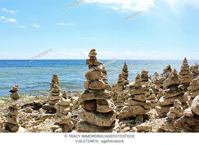 A large collection of rock totems, cairns, lining Lake Michigan's shoreline at Cave Point County Park, Sturgeon Bay, Door County, Wisconsin, USA