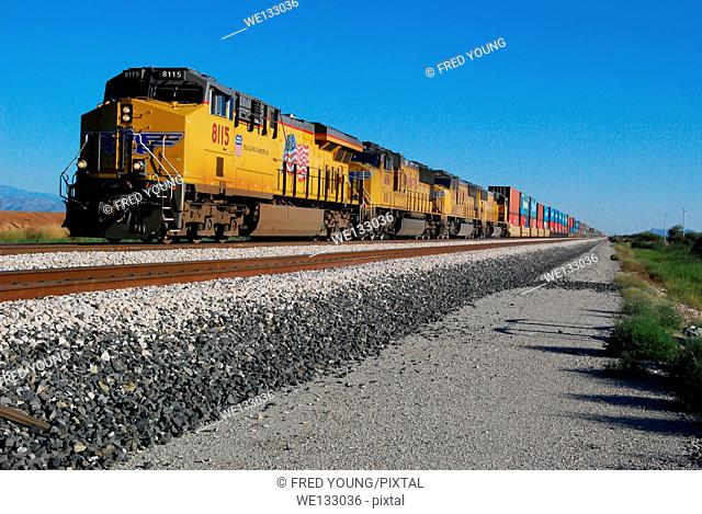 Picacho, AZ, USA - October 24, 2014: Approaching freight train loaded with cargo