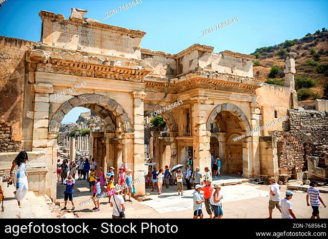 EPHESUS, TURKEY - AUG 01: visitors in Curetes street on August 01, 2014 in Ephesus, Turkey. Ancient Ephesus contains the largest collection of Roman ruins in...