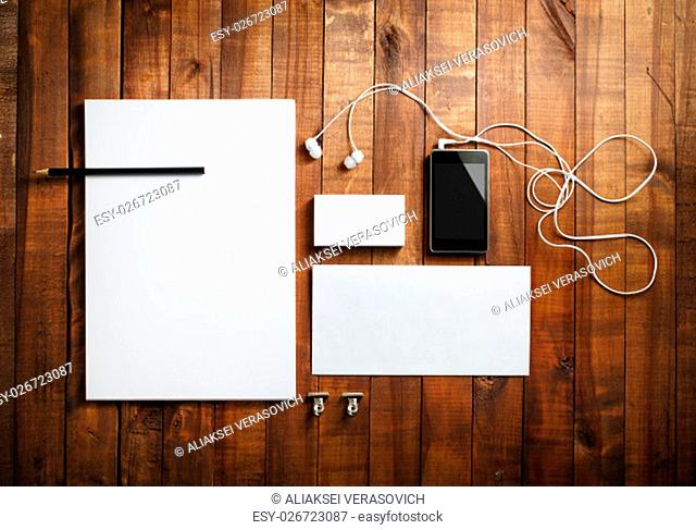 Blank stationery set. Blank letterhead, business cards, envelope, smartphone, headphones and pencil. Mock-up for branding identity for designers