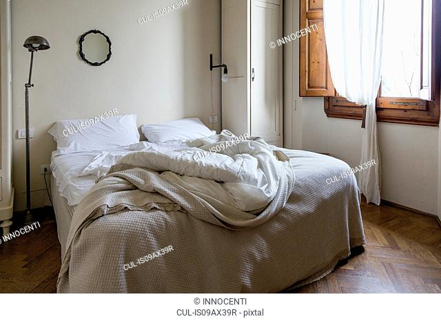 Unmade double bed