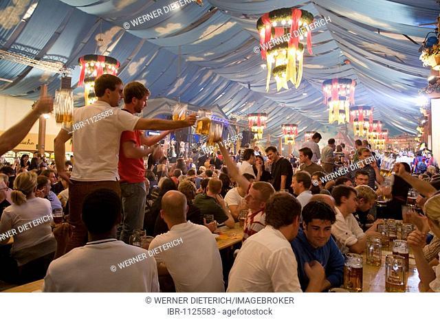 People drinking beer in a beer tent, Cannstatter Festival, Bad Cannstatt, Stuttgart, Baden-Wuerttemberg, Germany