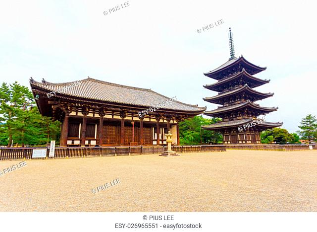 The front of the East Golden Hall, To-kondo, and five story pagoda, Goju-no-to, part of Kofuku-ji Buddhist temple on an overcast day in Nara, Japan