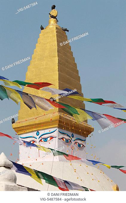 A small stupa with Buddhist prayer flags at Bodnath in Kathmandu, Nepal. - KATHMANDU, KATHMANDU VALLEY, NEPAL, 05/12/2011