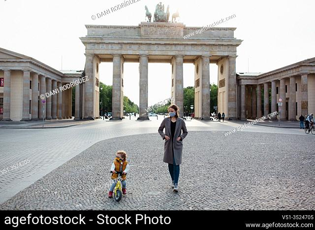 Mother and son walking in Berlin in Corona days