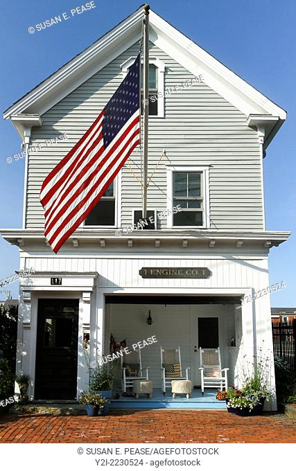 """A home that appears to have been fashioned from a former fire station, bearing the sign """"""""1 Engline Co. 1."""""""" Provincetown, Massachusetts, USA"""