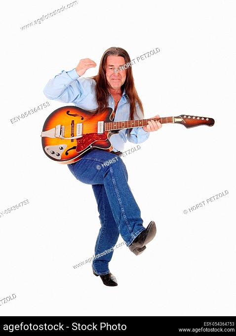 A happy musician dancing with his guitar with his long brunette.hair, singing, isolated for white background