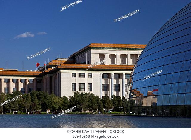 Facade to the National Centre for the Performing Arts, pond and front facade of the National People's Congress in Beijing, China