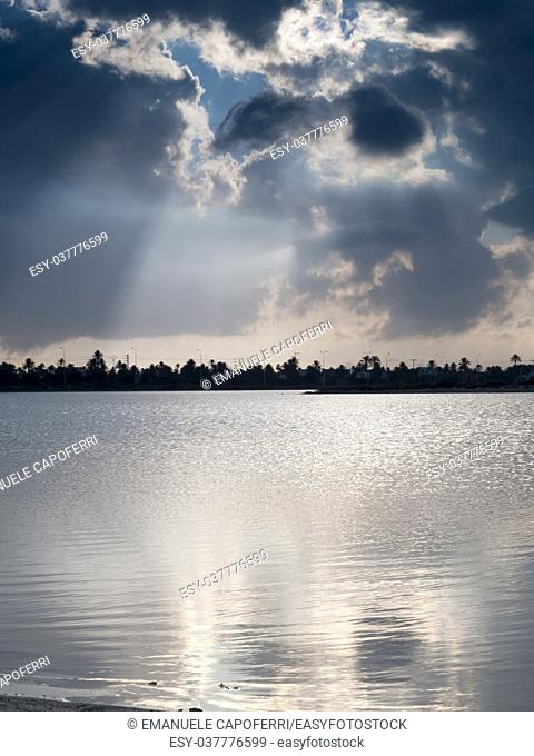 Djerba, Tunisia, lagoon, cloudy sky with rays of light that pierce the clouds