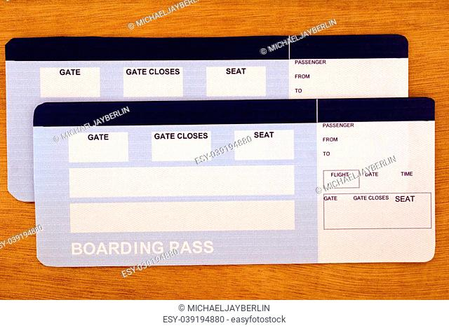 Fake flight tickets with empty spaces for your text on the table. Ready to go?