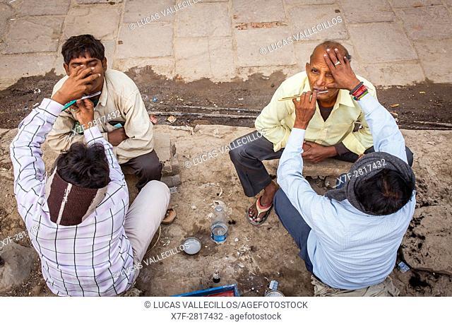 Morning shave, street scene in Assi Ghat, Ganges river, Varanasi, Uttar Pradesh, India