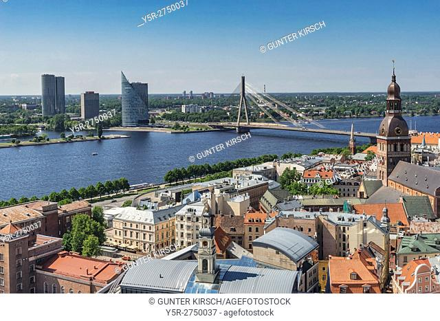 View over the old town of Riga to the cathedral, the river Western Dvina (Daugava), the Vansu bridge and the high-rise of the Schwedbank on the island of...