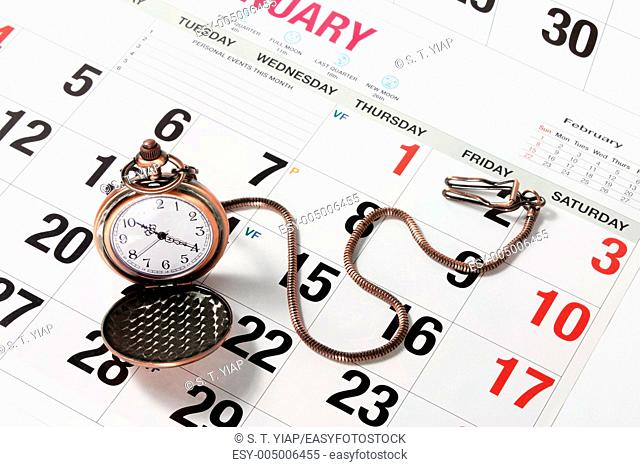 Pocket Watch on Calendar