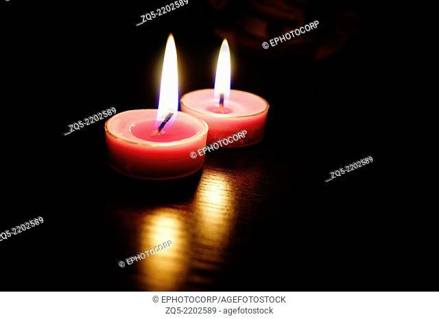 Close up of lit candles, Pune, Maharashtra, India