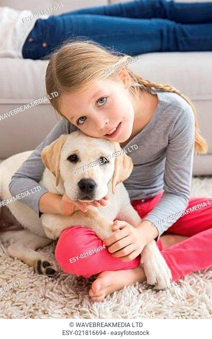 Happy little girl with her puppy