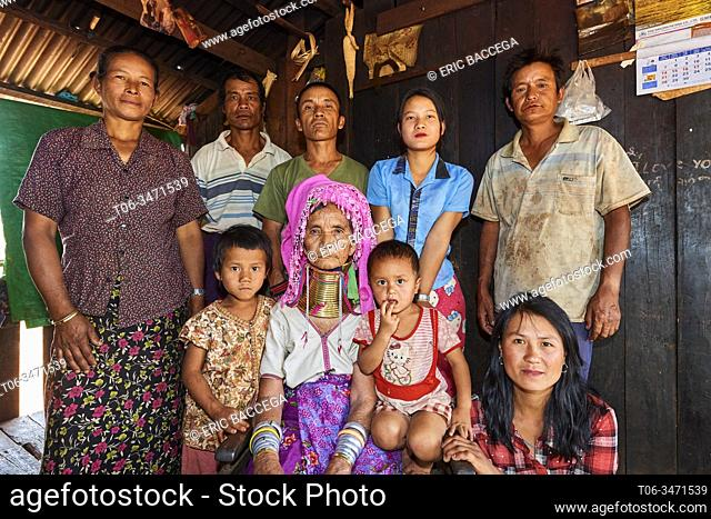 Multi-generational Kayan Lahwi peasant family portrait. The grand mother is wearing the traditional brass neck coils and clothing
