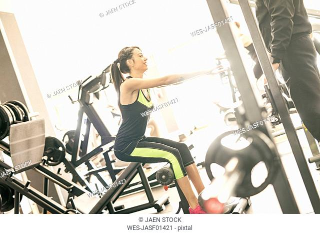 Young woman exercising in gym