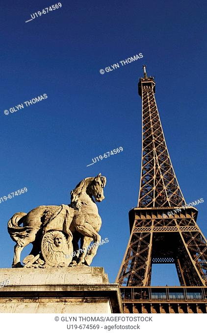 Statue on Pont de l'Alma with Eiffel Tower in background, Paris, France