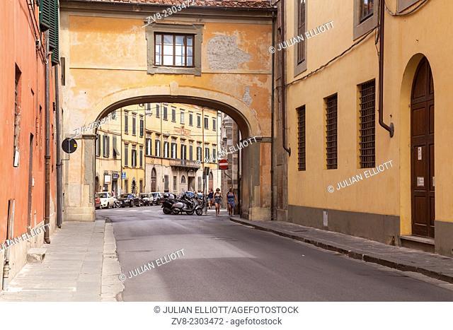 Via Santa Maria in Pisa, Italy. The bridge forms part of Palazzo Reale
