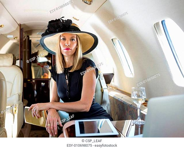 Rich Woman Sitting In Private Jet