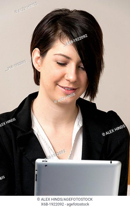 Young woman using ipad tablet computer