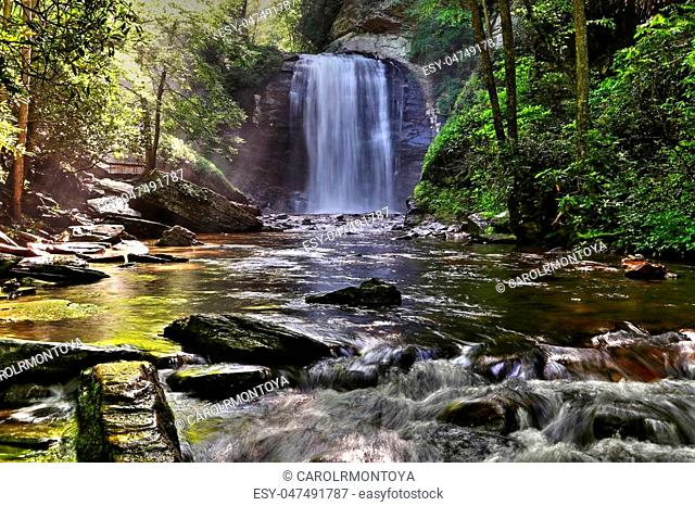Morning sun hit the top of the Looking Glass Falls. A tourist destination since it's right on U.S. 276, Forest Heritage Scenic Byway in Pisgah National Forest