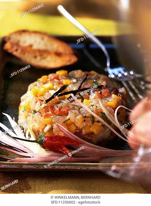 Fish and vegetable tartar with vanilla and grilled bread