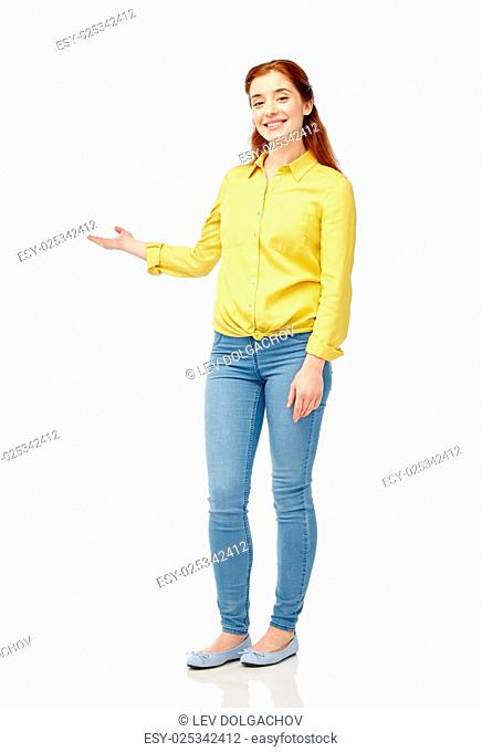 people and portrait concept - happy young woman holding something imaginary on hand over white