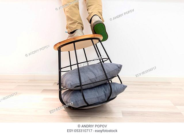 Man Standing On Sofa Table And About To Fall On Floor
