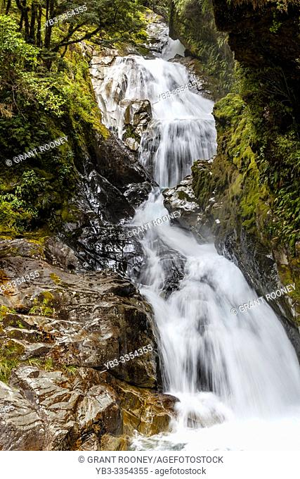 A Waterfall On The Milford Road, Fiordland National Park, South Island, New Zealand