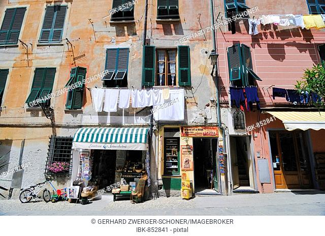 Facade of a house with a small shop and clotheslines, Vernazzo, Liguria, Cinque Terre, Italy, Europe