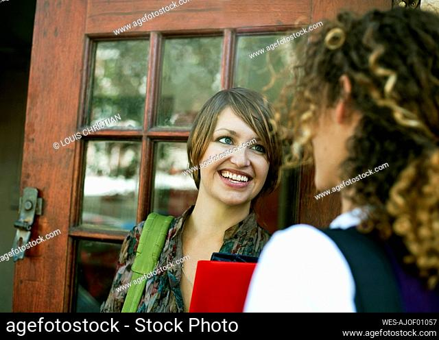 Female students talking to each other outside library